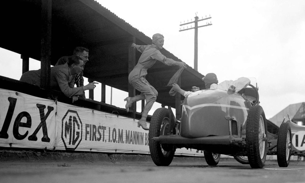 Doreen Evans takes the sash during the Relay Race at Brooklands in 1931. Evans first raced at the circuit aged only 17 and went on to drive for the MG Works team